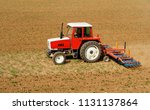 red and white tractor with a... | Shutterstock . vector #1131137864