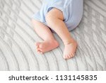 feet of the infant. the concept ... | Shutterstock . vector #1131145835