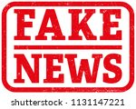red fake news rubber stamp... | Shutterstock .eps vector #1131147221