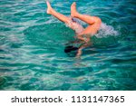 little girl enjoying snorkeling ... | Shutterstock . vector #1131147365