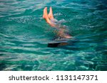 little girl enjoying snorkeling ... | Shutterstock . vector #1131147371