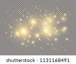 white sparks and golden stars... | Shutterstock .eps vector #1131168491