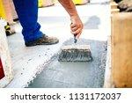 construction worker using brush ... | Shutterstock . vector #1131172037
