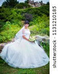 beautiful bride in luxurious... | Shutterstock . vector #1131210185
