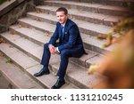 stylish groom in suit and tie... | Shutterstock . vector #1131210245