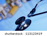 stethoscope and medicine bottles | Shutterstock . vector #113123419
