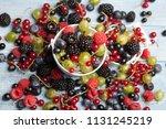 various fresh summer berries.... | Shutterstock . vector #1131245219
