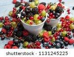 various fresh summer berries.... | Shutterstock . vector #1131245225