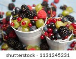 various fresh summer berries.... | Shutterstock . vector #1131245231