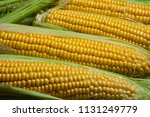 fresh corn on cobs on rustic... | Shutterstock . vector #1131249779