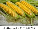 fresh corn on cobs on rustic... | Shutterstock . vector #1131249785