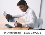 successful smiling software... | Shutterstock . vector #1131259271