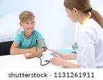 doctor checking little boy's... | Shutterstock . vector #1131261911
