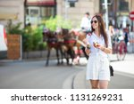 young woman with fruits in... | Shutterstock . vector #1131269231