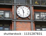clock on the red brick building. | Shutterstock . vector #1131287831