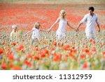 Family Walking Through Poppy...