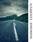 a long empty straight road ... | Shutterstock . vector #1131305174