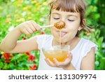 the child eats honey. selective ... | Shutterstock . vector #1131309974