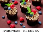 chocolate cupcakes with... | Shutterstock . vector #1131337427