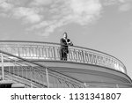 businessman on roof and look... | Shutterstock . vector #1131341807