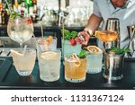 different alcoholic cocktails... | Shutterstock . vector #1131367124