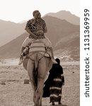 camel rides in the desert...   Shutterstock . vector #1131369959