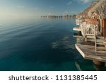overwater bungalows on the... | Shutterstock . vector #1131385445