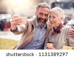 mature couple taking selfie... | Shutterstock . vector #1131389297