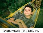 teenager boy resting in hammock ... | Shutterstock . vector #1131389447