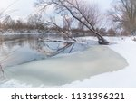 winter river. a winter river... | Shutterstock . vector #1131396221