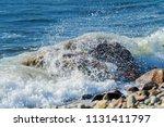 wave crash stony beach westport ... | Shutterstock . vector #1131411797