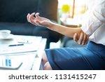 businesswomen's elbow pain  a... | Shutterstock . vector #1131415247