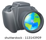 Camera globe concept, camera with globe in lens, could be for travel photography, a photography holiday or trip, or internet photography concept. - stock photo