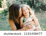 mother and daughter sit... | Shutterstock . vector #1131458477
