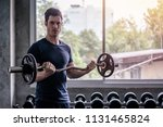 handsome weightlifter lifting... | Shutterstock . vector #1131465824