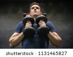 handsome weightlifter lifting... | Shutterstock . vector #1131465827