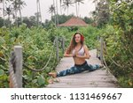 young woman practicing splits... | Shutterstock . vector #1131469667