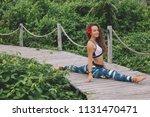 young woman practicing splits... | Shutterstock . vector #1131470471