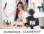 selective focus at camera ... | Shutterstock . vector #1131487577
