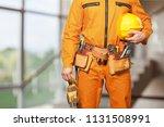 bricklayer hands holding hardhat | Shutterstock . vector #1131508991