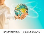 earth from space in hands ... | Shutterstock . vector #1131510647