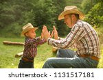 a  father and son of a cowboy | Shutterstock . vector #1131517181