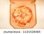hot pizza slice with melting... | Shutterstock . vector #1131528485