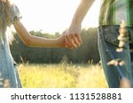 the parent holds the hand of a... | Shutterstock . vector #1131528881
