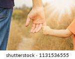 beautiful hands of a happy... | Shutterstock . vector #1131536555