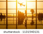 silhouette of young family with ... | Shutterstock . vector #1131540131