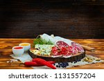 sliced cured sausage with... | Shutterstock . vector #1131557204