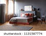 grey wooden armchair next to...   Shutterstock . vector #1131587774