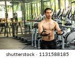 young sport man exercising in... | Shutterstock . vector #1131588185