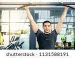 young sport man exercising in... | Shutterstock . vector #1131588191